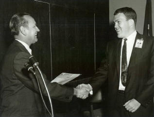 Jack receiving an award from Chris Kraft.